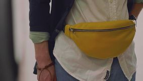 View of yellow fanny pack on waist of male model during photoshoot stock footage