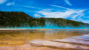 The purple fog in yellowstone national park. A view in yellowstone national park, blue sky echoes purple steam royalty free stock image