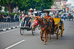 View of Yogyakarta with its typical hundreds of motorbikes on th Stock Photos