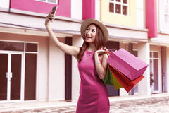 View of a young attractive asian woman with hat taking selfie. While shopping Stock Photography