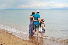 View of young family having fun on the beach. Happy young family having fun on the beach Stock Image