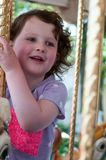 Young girl riding on fairground horse on carousel amusement ride at fairgrounds park outdoor. View of Young girl riding on fairground horse on carousel amusement Stock Photos