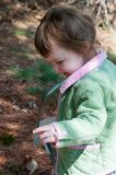 Young little toddler girl with basket searching for easter eggs Royalty Free Stock Photo