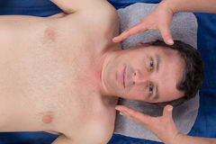 View of a young man at health spa. Close up view of a young man receiving alternative therapy at health spa Stock Photos