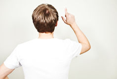 View of young man pointing up Stock Image