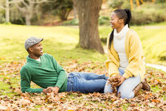 View of a young smiling couple in leaves Stock Photo