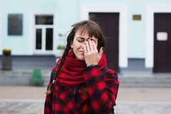 View of a Young student woman having a headache due to stress and anxiety. View of a Young student women having a headache due to stress and anxiety - Burn out Royalty Free Stock Images