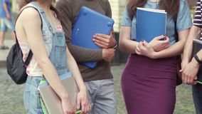 View of young students standing on front of university. stock video footage