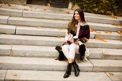 View at young woman sitting outside Royalty Free Stock Photo