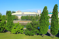 View of Yunost sports palace from the trestle bridge in the morning in June Royalty Free Stock Photo