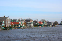 Zaanse Schans Village. A view of the Zaanse Schans village, universally known for windmills, in a sunny but windy day Stock Photos