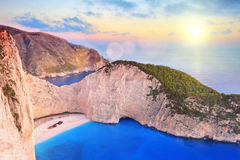 View of Zakynthos island, Greece with a shipwreck on a beach. View of Zakynthos island, Greece with a shipwreck on the sandy beach, at sunset Royalty Free Stock Photography