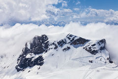 View from Zugspitze.Germany. Clouds on snow mountains. Germany Stock Photography