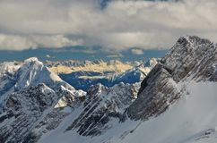 Dramatic Snow Capped Mountain Peaks in the German. Panoramic view of the German and Austrian Alps in sunset from the Zugspitze Glacier, the highest mountain in Stock Photography