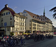 View of Zytglogge center with bicycle parking from UNESCO Bern city. Switzerland. Zytglogge center with bicycle parking on sunset from UNESCO Bern city Royalty Free Stock Images