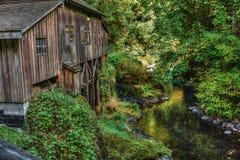 Cedar Creek Grist Mill near Woodland, Washington State. Viewed from the covered bridge, Woodland, Washington State Stock Image