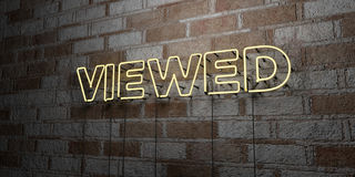 VIEWED - Glowing Neon Sign on stonework wall - 3D rendered royalty free stock illustration Royalty Free Stock Photo