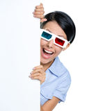 Viewer in 3D glasses peeps out from behind the copyspace Stock Photos