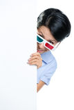 Viewer in 3D spectacles peeps out Royalty Free Stock Photography