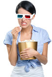 Viewer watching 3D cinema with popcorn Royalty Free Stock Photo