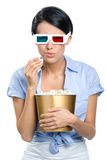 Viewer watching 3D film with bowl of popcorn Royalty Free Stock Photos