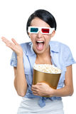Viewer watching 3D film with popcorn stock images
