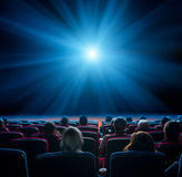 Viewers in cinema with blue star Stock Photo