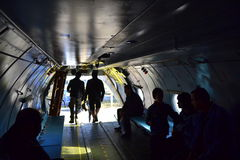 Viewers examine An-26 military craft interior Stock Photo