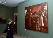 Viewers at the exhibition in Moscow state school of watercolour of Sergei Andriyaka in the painting `Tsar Ivan IV, surrounded by p Royalty Free Stock Photo