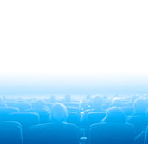Viewers at movie theater, blue toning white copy space Stock Image