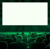 Viewers at movie theater, green toning Stock Photography