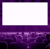 Viewers at movie theater, violet toning Stock Image
