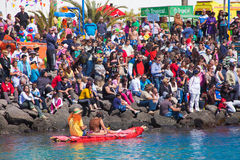 Viewers watch as participants take to water in yearly Regata de Achipencos in Puerto del Rosario Stock Photos