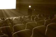 Viewers watch 3D movie, sepia toning Stock Photography