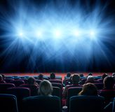 Viewers watch shining lights in the cinema hall Royalty Free Stock Image