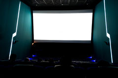 Viewers watching movie at cinema with screen isolated in white, long exposure Stock Images