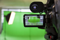 Viewfinder on an HD TV Camera. LCD display screen on a High Definition TV camera in a green screen studio Stock Photos