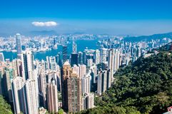 Viewin för tid för Hong Kong City horisontdag från Victoria Peak Arkivbild