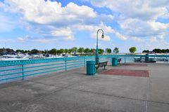 Viewing Area in Racine Wisconsin Harbor. The port of Racine Wisconsin has a viewing area to sit and watch the harbor. Light blue clouded skies in the area where royalty free stock images