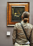 Viewing art. A lady looking at a framed painting in a museum stock photo