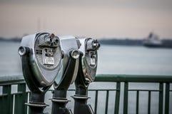 Viewing binocular. Public pay binocular beside the river stock images