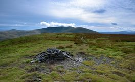 Pile of stones making the summit of the fells. Viewing Blencathra from Lonscale Fell Stock Images