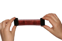 Viewing the film. The Hands sprain the film.Viewing the personnel(frames Stock Images