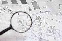 Viewing forex charts through a magnifying glass. Viewing forex charts through a magnifying glass stock image