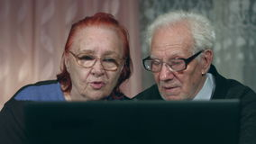 Viewing laptop elderly couple. 2 shots stock video footage