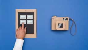Viewing pictures on a carboard tablet Royalty Free Stock Photography