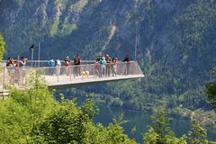 Viewing Platform in Hallstatt with a spectacular view of Lake Hallstatter See, Austria, Europe. Hallstatt, Austria - June 18, 2017: The World Heritage Viewing royalty free stock photo