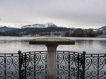 Viewing platform overlooking a lake and mountains Stock Photo