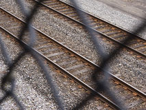 Viewing railroad tracks through chain-link fence Stock Photos