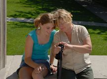 Viewing Results. Grandmother and granddaughter viewing the back of a digital camera to see picture Stock Image
